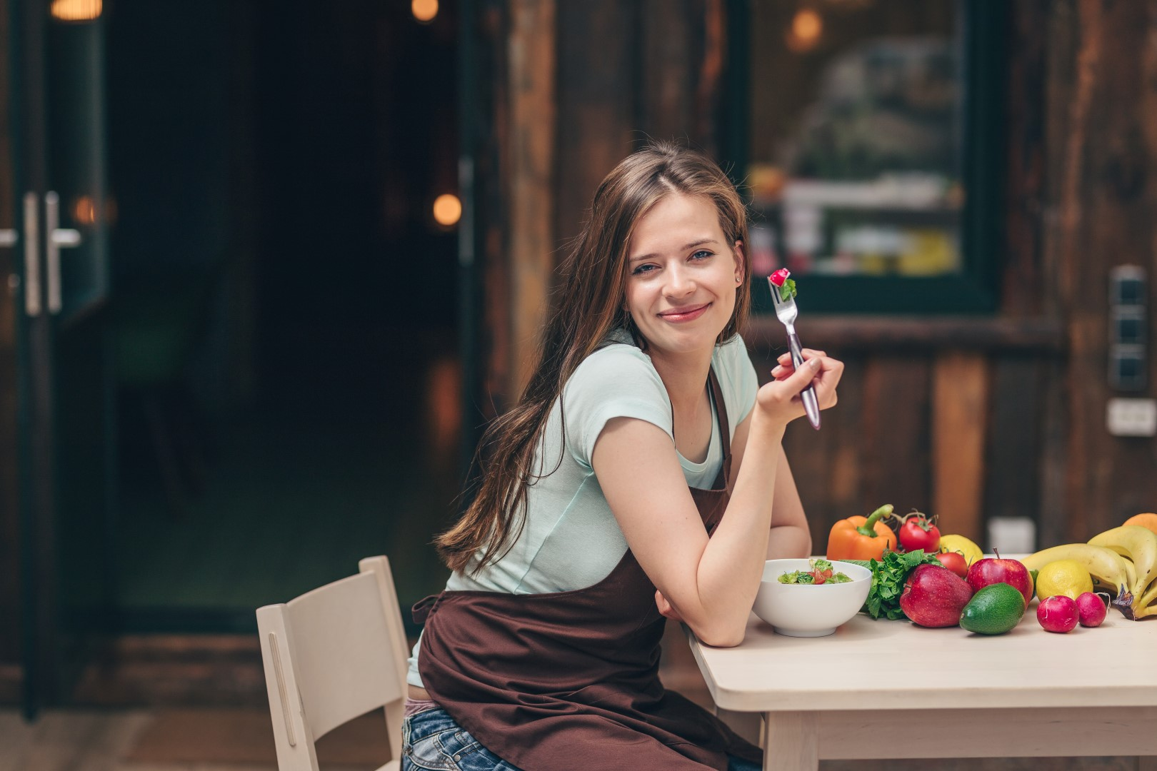 Young attractive girl eating in cafe